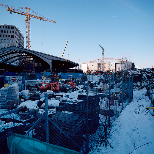 The Friends Arena in the back, the old storage halls in front. Arenastaden, Solna, January 2011.