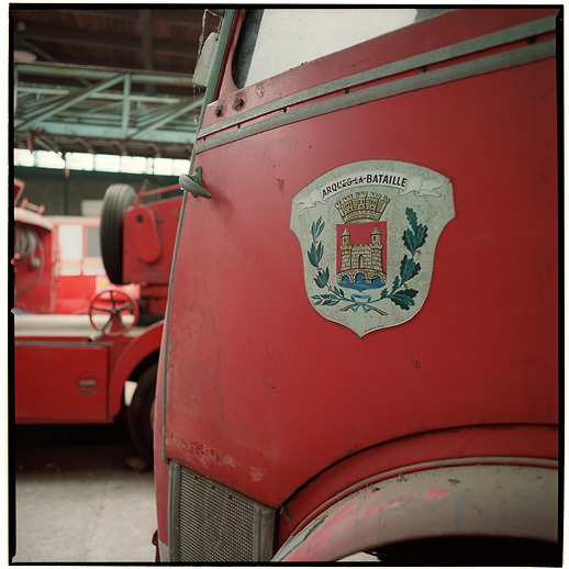Arques-la-Bataille had a nicely hand painted symbol of the community on this truck at Cimetière camions de pompiers, France.