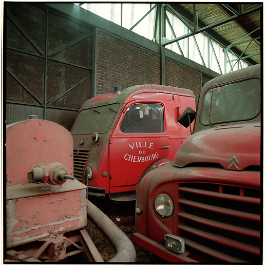A Renault and a CitroÃ«n truck, hanging out at Cimetière camions de pompiers, France.