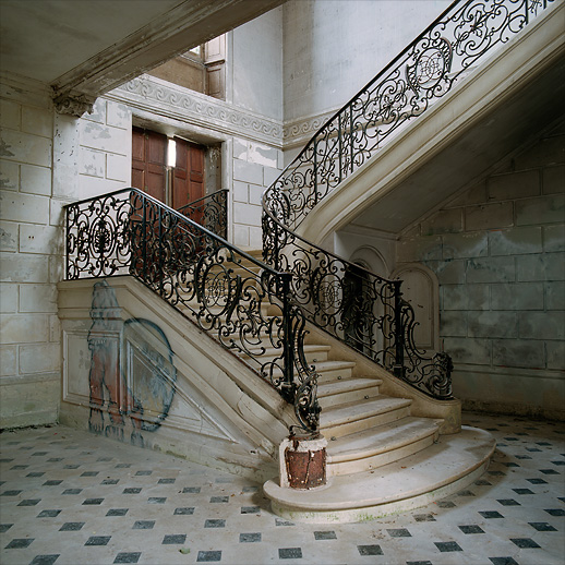 The famous stairway. The graffiti had been crossed put as a protest against scribbling in such an environment at Château of Singers, France.