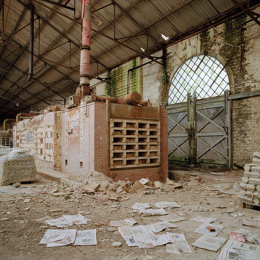 Hall of kilns. Packed up pallets ready for shipping still standing around at Kakelfabriken / The Tile Factory. France.