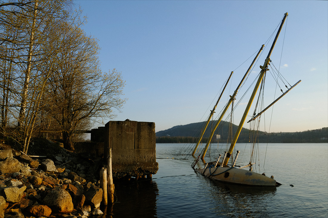 The infamous schooner M/S Heri sunk to rest by the mill's harbour at Nyhamns sulfitfabrik. Essvik, Medelpad, Sweden. May 2008.